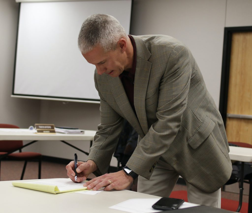 Dr Overbo signs supt contract